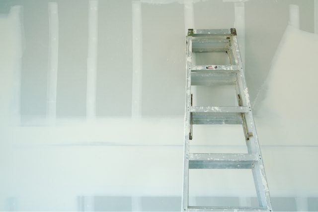 Drywall Project inside a home with a ladder